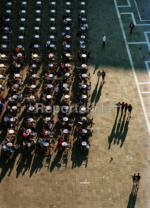 Shadows of people, cafe tables and pigeons on the paving stones of St Marks Square, Venice, Italy. - Paul Carter - 2001-04-06