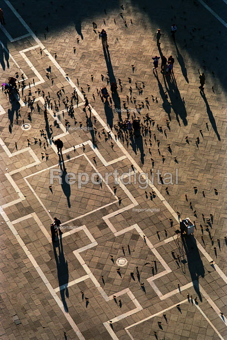 Shadows of people and pigeons on the paving stones of St Marks Square, Venice, Italy. - Paul Carter - 2001-04-06