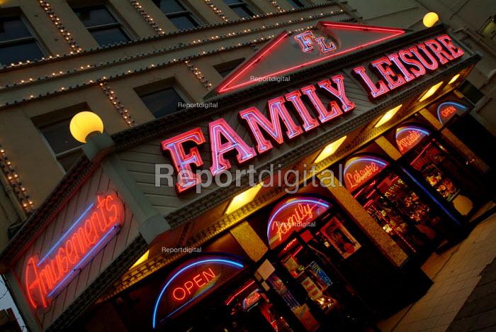 Neon lights of an amusement arcade. - Paul Carter - 2003-08-01