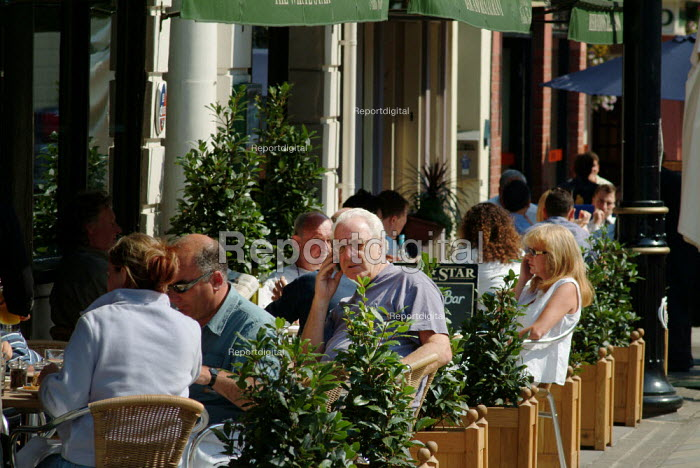 Customers eating lunch at tables outside a restaurant. - Paul Carter - 2003-09-04