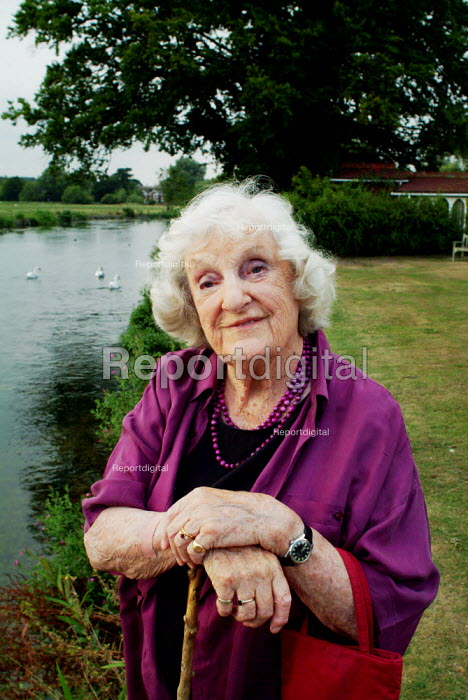 Portrait of an elderly woman next to a river. She is resting on a walking stick. - Paul Carter - 2003-08-17