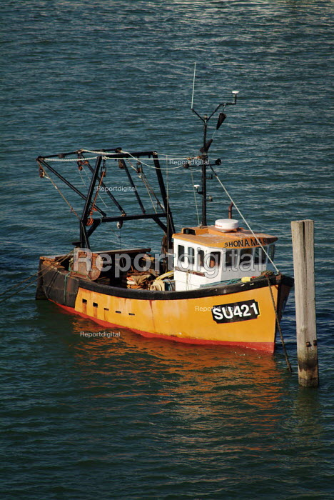 Small orange fishing boat, moored on the River Itchen, Hampshire. - Paul Carter - 2003-07-09