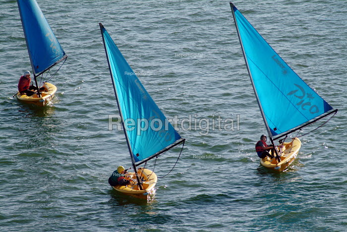Three sailing boats on a river, wind billowing in the sails. - Paul Carter - 2003-09-09