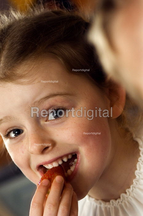 Girl eating a strawberry. - Paul Carter - 2006-01-07