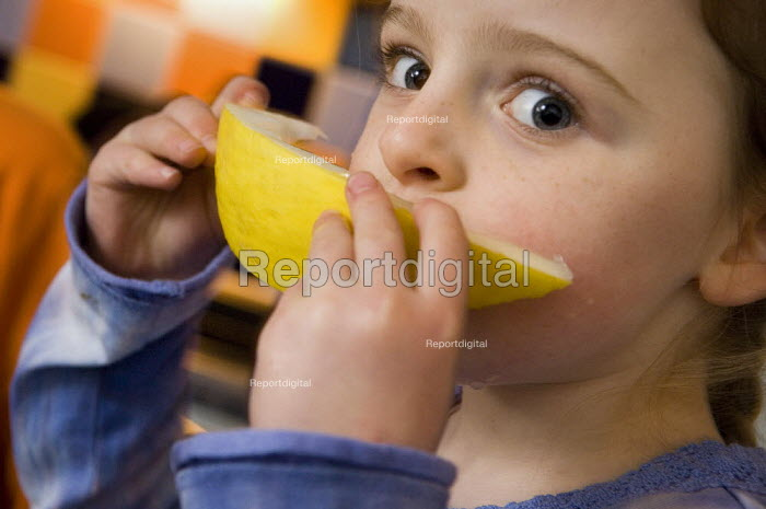 Young girl eating a slice of melon. - Paul Carter - 2006-01-07
