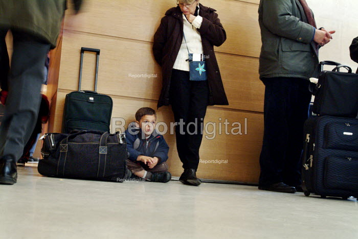 Young boy waiting at a busy train station. - Paul Carter - 2003-10-25