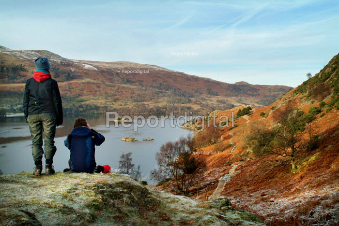 Two walkers rest, looking over Ullswater, The Lake District. - Paul Carter - 2003-12-30