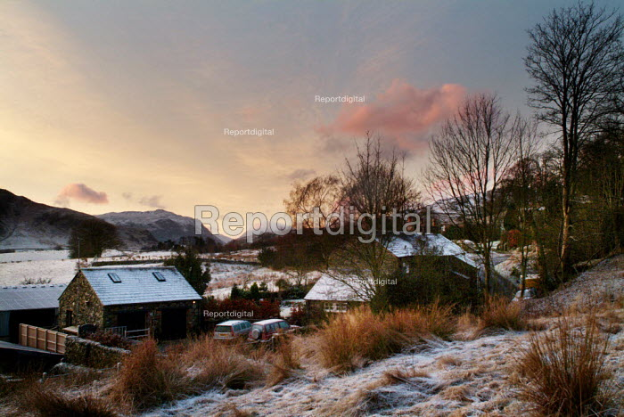 Sunrise over a small row of cottages and a farm, The Lake District. - Paul Carter - 2003-12-31