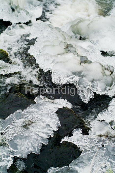 Sections of ice frozen over a fast flowing stream. - Paul Carter - 2003-12-31