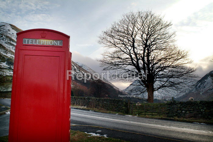 Bright red telephone box on the side of a road. The Lake District - Paul Carter - 2004-01-02