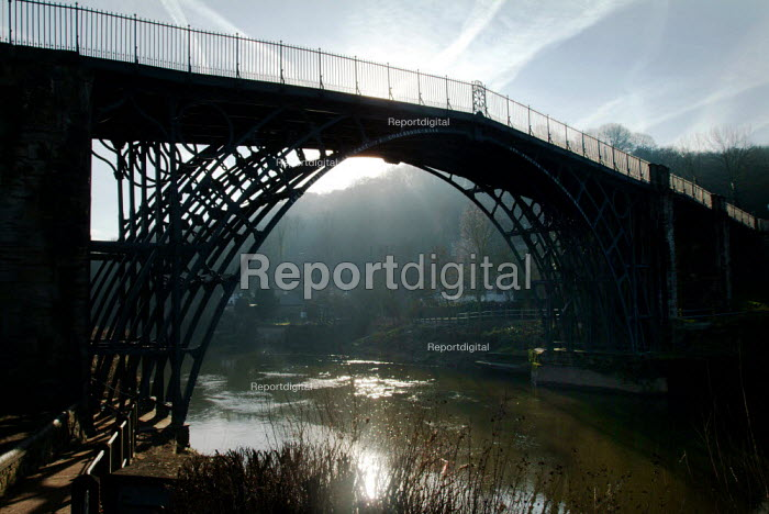 View of the Iron Bridge. It was the first ever bridge made of iron and it spans the river Severn. It was designed and built by Abraham Darby who completed it in 1779. Ironbridge, Shropshire. - Paul Carter - 2004-02-20