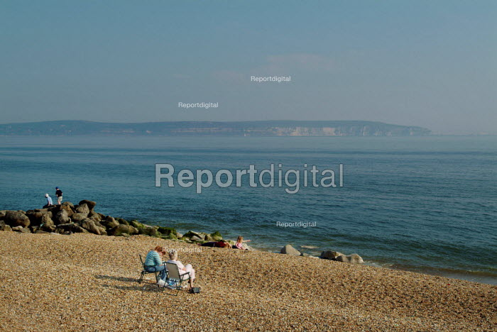 Sitting on the beach, relaxing. Looking out over to the Isle of Wight and the Needles. Milford-on-Sea, Hampshire. - Paul Carter - 2003-05-29