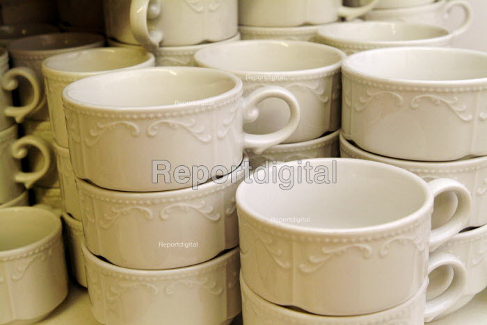 White china cups stacked in a cafe, waiting to be used. - Paul Carter - 2004-07-27