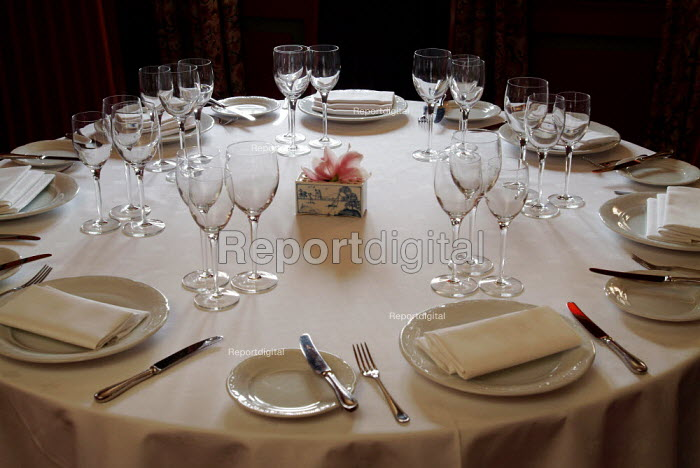 Table in a restaurant, laid for the evening meal. - Paul Carter - 2004-07-27