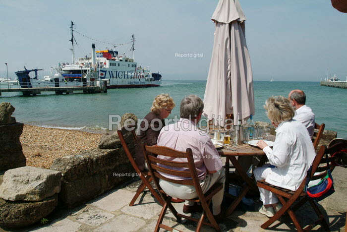 Friends enjoying lunch in a pub garden, overlooking the Solent. A WightLink Isle of Wight ferry enters the port. - Paul Carter - 2004-07-27