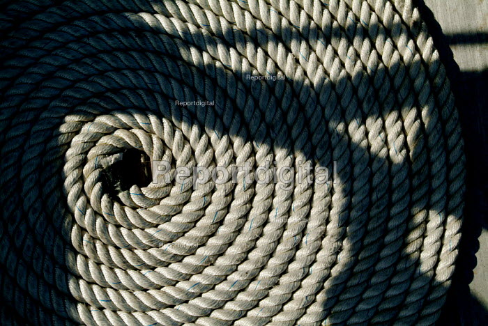 Close up of a shadow falling on coiled rope on the deck of HMS Victory, Portsmouth. - Paul Carter - 2003-06-13