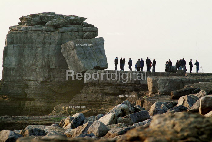 Tourists walking out to Pulpit Rock, created by quarrying. Portland Bill, Dorset. - Paul Carter - 2004-02-14