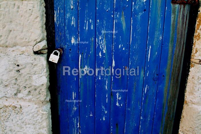 Padlocked door on a stone hut at Portland Bill, Dorset. - Paul Carter - 2004-02-14