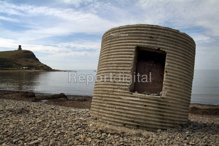 Concrete pillbox on the beach at Kimmeridge, Dorset with Clavel's Folly, or Kimmeridge Tower in the distance. - Paul Carter - 2004-08-03