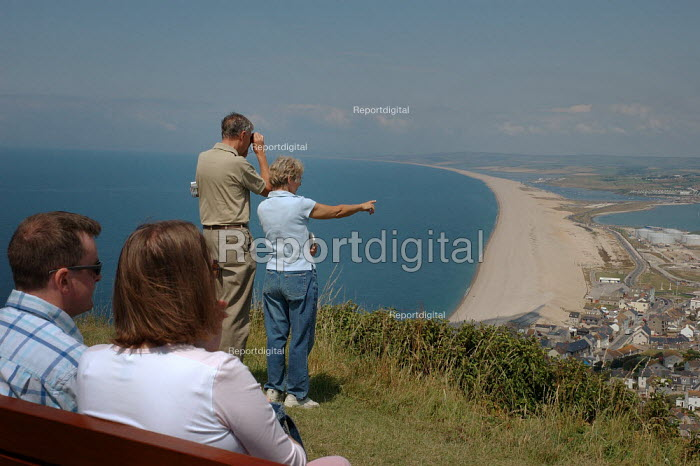 Couples admiring the view from the viewpoint on top of the hill at Castletown, Fortunesewell, Isle of Portland. Dorset. - Paul Carter - 2004-07-13