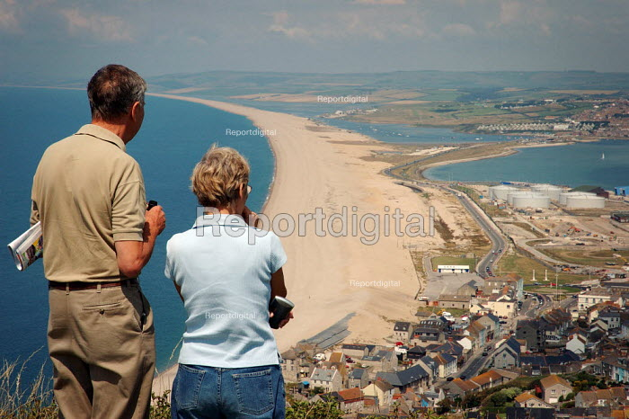 Couple admiring the view from the viewpoint on top of the hill at Castletown, Fortunesewell, Isle of Portland. Dorset. - Paul Carter - 2004-07-13
