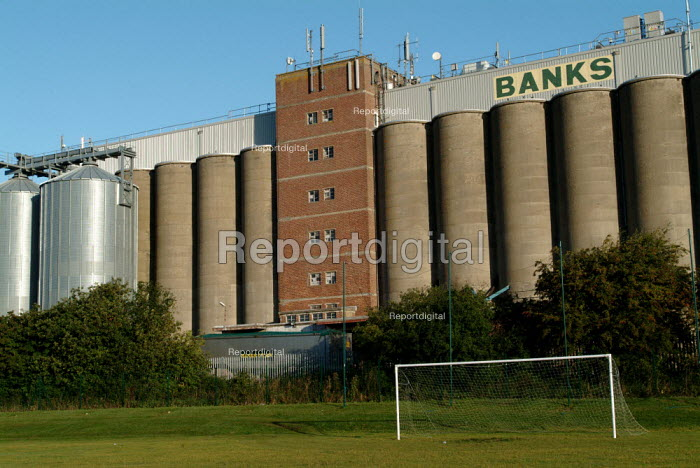 Grain silos next to a school playing field with football goal. - Paul Carter - 2004-09-16