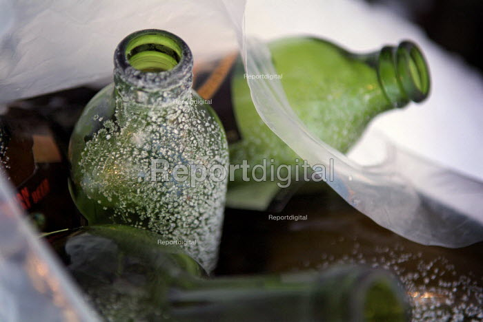 Frost and snow on empty glass beer bottles in a bag, waiting to be recycled. - Paul Carter - 2004-12-26