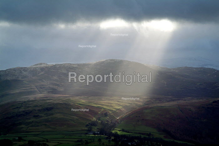 Shafts of sunlight over Keswick and Derwent Water viewed from Little Man. The Lake District. - Paul Carter - 2004-12-28
