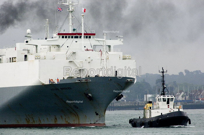 UECC car transporter ship entering Southampton harbour docks with the help of tugs. - Paul Carter - 2006-05-17