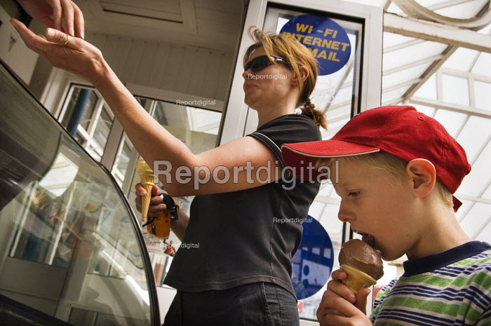 Buying ice creams from a ice cream parlour on a hot day. - Paul Carter - 2006-06-05