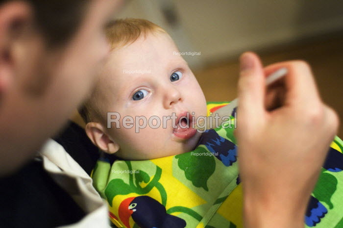 A father feeding his son. - Paul Carter - 2005-10-22