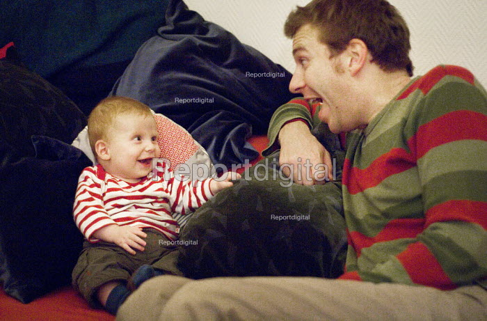 A father and his son sitting on the sofa. - Paul Carter - 2005-10-22