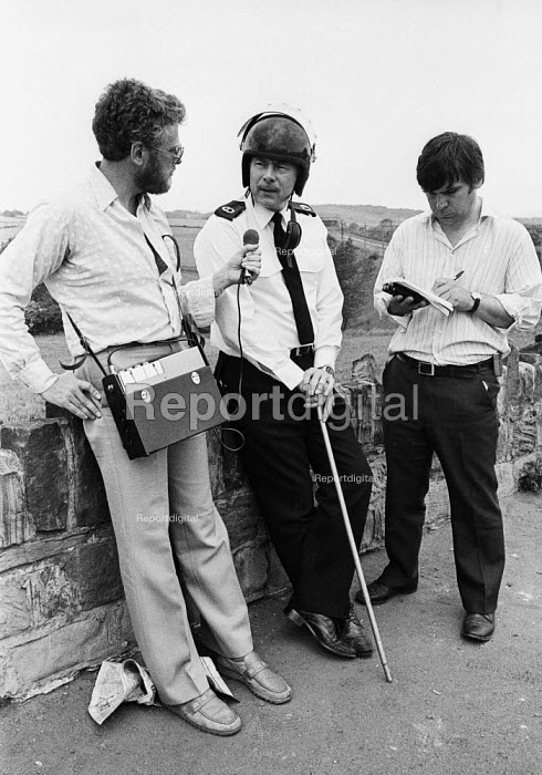 Tony Clement, Assistant Chief Constable of South Yorkshire Police, talking to reporters at Orgreave Coking works after miners and police officers clash on the picket lines - John Harris - 1984-06-18