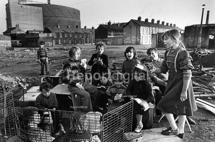 Children make believe a classroom, Markets redevelopment area, Belfast, Northern Ireland 1985 - John Sturrock - 1985-07-10