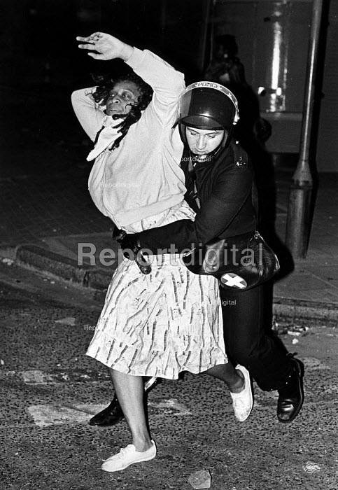 Brixton Riots. Clashes broke out between police and demonstraters after the shooting by police or innocent black woman, Cherry Groce. - John Sturrock - 1985-09-28