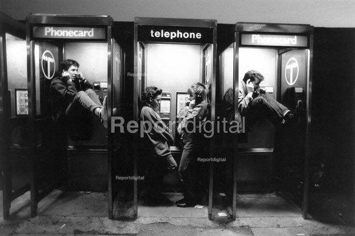 Teenagers in the telephone boxes, on a Saturday night in... - John Sturrock, JS09AR182.jpg