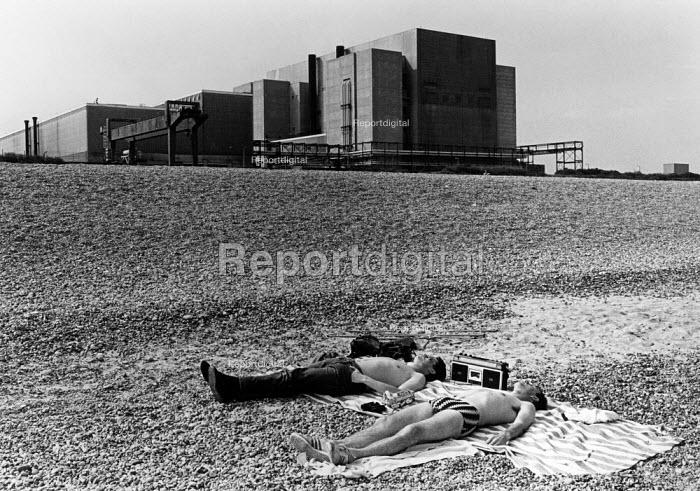 Two men sunbathing in front of Sizewell nuclear power station 1983 - John Sturrock - 1983-06-20