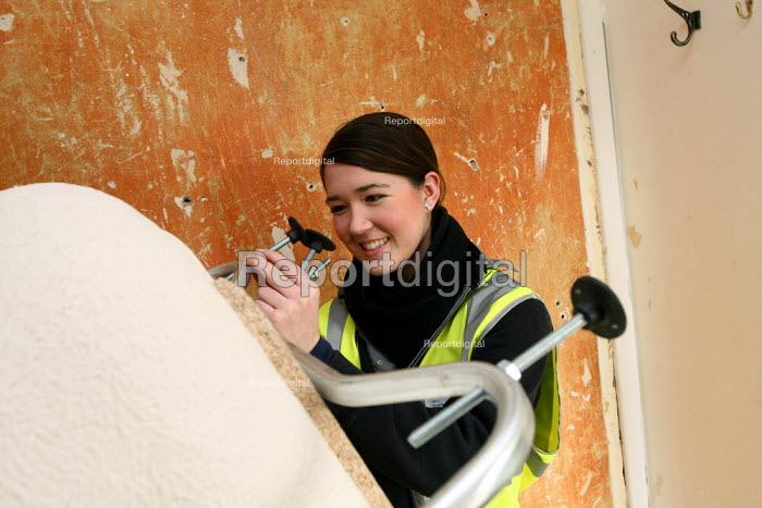 Apprentice working for her NVQ level 2 in plumbing, being... - Justin Tallis, JT1003nch100.JPG