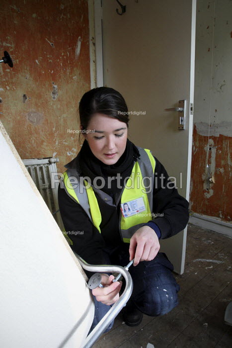 Apprentice working for her NVQ level 2 in plumbing, being... - Justin Tallis, JT1003nch102.JPG