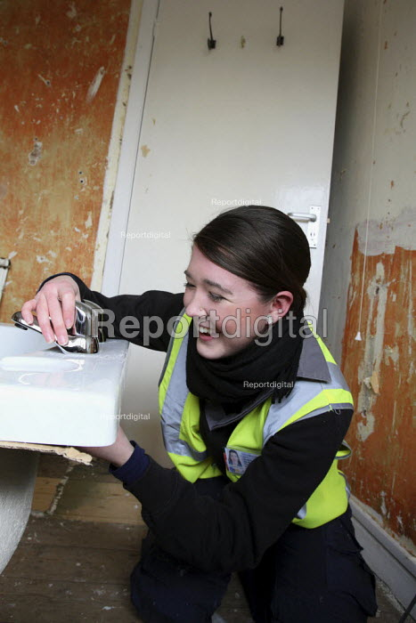 Apprentice working for her NVQ level 2 in plumbing... - Justin Tallis, JT1003nch106.JPG