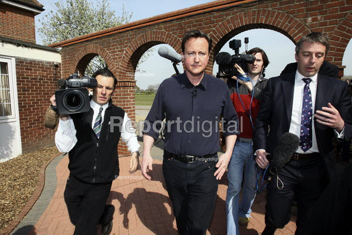 David Cameron walking through the media after giving a speech to Conservative Party supporter at a campaign event in Thurrock, Essex. - Justin Tallis - 2010-04-24