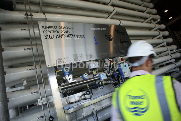 A worker walks past pressure vessels at Thames Gateway Water Treatment Works. It is first plant of its kind to be built in the UK converting brackish water from the River Thames into clean drinking water as well as the only place in the world to use first four-stage reverse osmosis. Becton, Greater London. - Justin Tallis - 2010-06-17