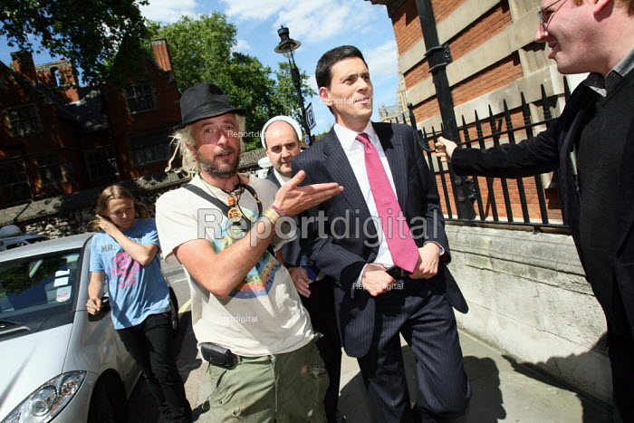 David Miliband MP walking away after he is confronted by... - Justin Tallis, JT1006187.JPG