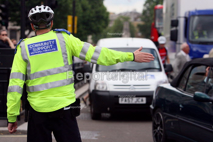 Police Community Support Officer directing heavily... - Justin Tallis, JT1007070.JPG