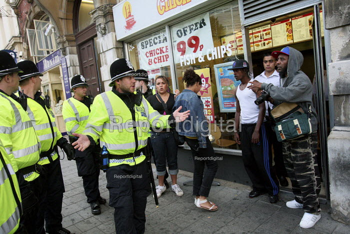 Police officers asking people to move along. EDL march in... - Justin Tallis, JT1007164.JPG