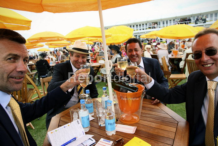 Racegoers enjoying themselves at Venue Cliquot champagne bar. Goodwood racecourse. - Justin Tallis - 2010-07-29