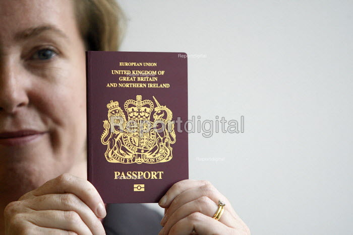 Sarah Rapson, chief executive of the Identity and Passport Service posing with a specimen of the newly designed UK passport during unveiling at the Passport Office in London. - Justin Tallis - 2010-08-25