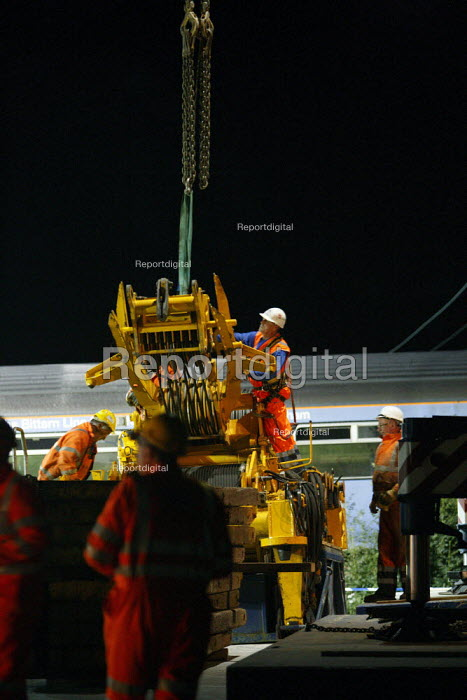 Recovery workers moving a huge winch in preparation to... - Justin Tallis, JT1008T318.jpg