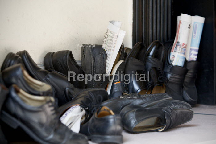 Shoes with newspapers in them left outside for friday... - Justin Tallis, JT1009028.JPG