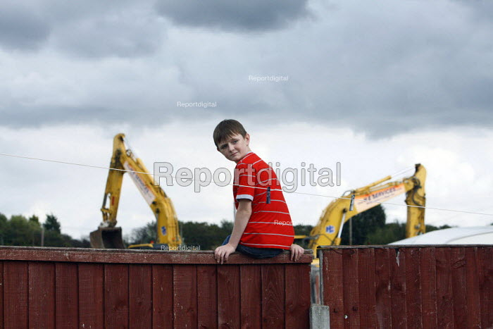 A traveller boy looks on as diggers begin to raise to the ground their pitch of land, legally owned by the travellers, after the council served an eviction notice. Hovefields Drive in Basildon. - Justin Tallis - 2010-09-07